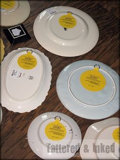 How to Hang Your Plates on the Wall:  Yellow Disc plate hangers that attach to the back of the plate.
