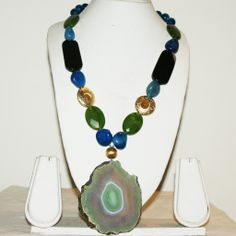 Rare Green Volcanic Flat Plate Pendant Necklace wtih a delightful combination of colour co-ordinated stones. Natural and Dignified in a rare combination!
