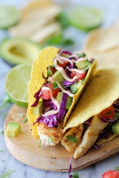 Fish Tacos with Chipotle Mayo - alternative to mango and tomato, uses red cabbage and dressing