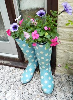Welly Boot Plant Pots - Drill a few drainage holes around the edges of the base of the boots, drop a few pebbles to the bottom and then fill with soil. Then fill your boots with a variety of flowers to compliment your welly design. I used geraniums, begonias and petunias.