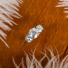 A beautiful estate diamond jewelry engagement ring, featuring 3 diamonds.