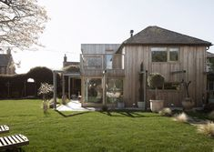 Paul Cashin Architects creates timber extension for coastal Island Cottage Larch Cladding, Reserva Natural, Timber Windows, Studios Architecture, Old Cottage, Modern Architects, Log Burner, Chichester, Contemporary Architecture