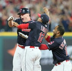Cleveland Indians Francisco Lindor and Edwin Encarnacion jump on Jay Bruce after Bruce knocked in the winning run in the 10th inning to beat the Kansas City Royals 3-2 at Progressive Field, Cleveland, Ohio, on September 14, 2017. The Indians winning streak is now at 22. (Chuck Crow/The Plain Dealer).
