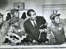 """B & W still from the American film """"Grand Prix"""" (1966) starring American actor James Garner and Japanese legend Toshiro Mifune."""