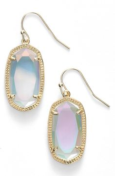 "I wish this stone came in the largest size, Danielle. ~ 'Dani' Stone Drop Earrings - Beautifully etched metal frames shimmering oval stones that swing from bold drop earrings. 1 1/2"" drop; 1/2"" width. French wire. 14k-gold or rhodium plate/magnesite, mother-of-pearl, opal or agate. By Kendra Scott; imported."