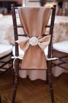 Mauve satin chair treatment with pearl adornment. Photography By / kellyhornberger.com, Planning By / charitylykins.com, Floral Design By / florabelladesigns.net