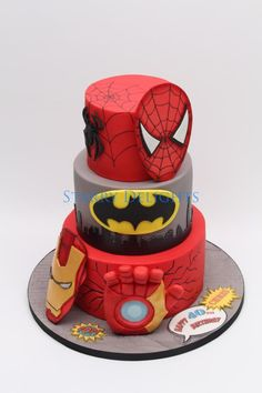 Superhero cake - ironman, batman, spiderman - Cake by Starry Delights. It's perfect but maybe Optimus Prime instead of Spider-Man Fancy Cakes, Cute Cakes, Pastel Avengers, Decors Pate A Sucre, Ironman Cake, Avenger Cake, Superhero Cake, Character Cakes, Cakes For Boys