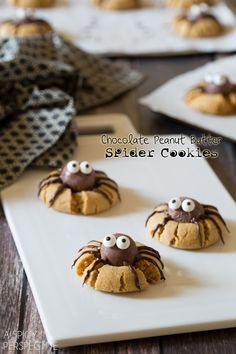 Spider cookies! Peanut butter cookies with Lindor truffle spider bodies. The legs are piped melted chocolate. Edible candy eyes.