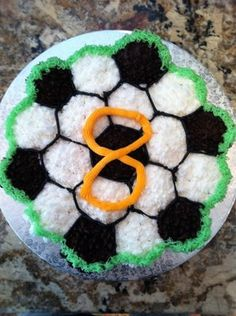 Soccer ball cupcake cake with chocolate filling.