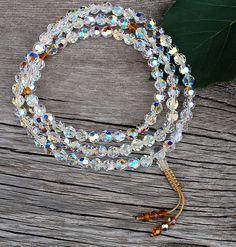 Swarovski Crystal Mala. 108 8mm cool, clear faceted Swarovski Crystal beads w/Citrine-colored markers, finished w/aQuartz Crystal guru bead & adjustable Snakeknot.