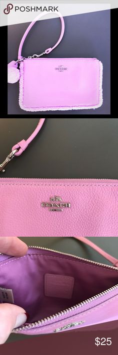 Coach Pink leather with fuzzy trim wristlet. Coach Shearling Small Pink pebbled leather with faux fur trim, Pom Pom and silver hardware.   Excellent condition. Super cute wristlet for the young lady. Coach Bags Clutches & Wristlets