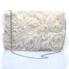 #KUNST Ivory #clutch. Simple and classy ivory silk flower cross body bag. #BollywoodandFashion