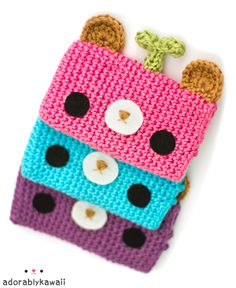 knitted and crochet kawaii cases for iphones/ipods/smartphones! for pencils for make up for clutch bag the size is easily adaptable I'd put a fabric lining in it and velcro or zip at the top cute kawaii japan lovers gift