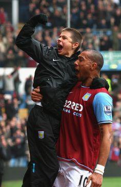 John Carew celebrates with the ball boy as Villa beat Blues 5-1
