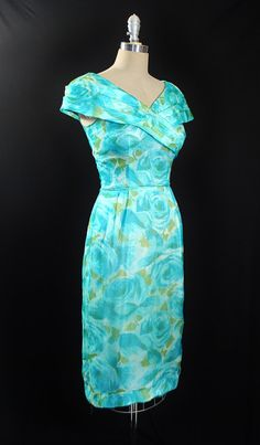 Love the color! I could see wearing this often :) Vintage 1950s CHIFFON Overlay Turquoise Floral by GeronimoVintage