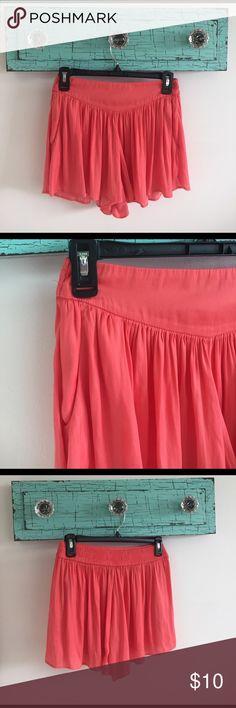 peach shorts Peach shorts. Looks like a skirt, really shorts. Has pockets. Elastic waistband. Very comfortable. Lightweight. Bershka Shorts