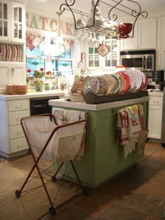the little red laundry cart is used to store kitchen linens.