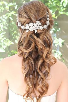 This glamorous half-do is perfect for any indoor wedding, or a wedding in the city. This flower crown hairstyle is also beautiful for any hair length.