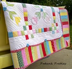 Podunk Pretties: Promenading Tulips Finished!-Love this border and the quilting on the border