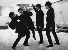 Members of The Beatles play in the snow outside Washington, D.C.'s Coliseum where they were scheduled to perform before a sell-out audience in 1964.