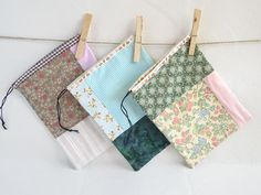 Useful unique green drawstring pouch.  Drawstrings patchwork  pouch is perfect for your most delicate things. It also will keep all your favourites in one place when traveling.   You can hang it on a bathroom door or a bed post.     Hand made cotton sachet is:  > inch 7,87 x 5,9 - cm. 20 x 15  > hand made with printed cotton fabric   > finished with ribbons at the edge  > lined with white cotton fabric  > Care By: Machine Wash in Cold on Delicate. Do not dry in dryer - lay flat to dry. Iron…