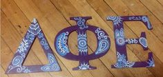 Dphie letters made by big for little2's big/little reveal! [ Delta Phi Epsilon sorority panhellenic greek life ΔΦΕ diy wooden letters paisley purple blue white unicorns crafting ]