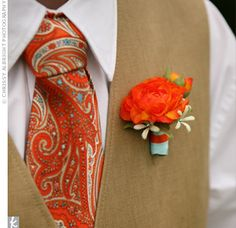 Tim wore an orange ranunculus boutonniere accented with studded stephanotis and wrapped with light-blue ribbon. His orange paisley tie and tan suit were a playful alternative to the standard black tux.