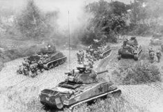 American infantry and armor of the 10th Army advancing on Okinawa