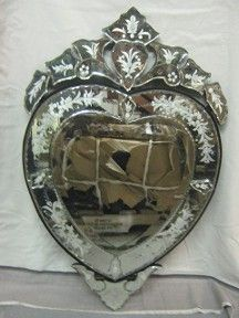 Glass Heart Venetian Mirro $185.00. This mirror is perfect for adding elegance and charm to a room.