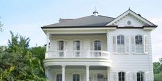 """""""This was a resurrection not a renovation,"""" says homeowner Gary Laborde with a chuckle. The 1884 Italianate house in New Orleans' stately St. Charles Avenue was in near tear-down state when Laborde and his wife, Betsy, bought it with the intention of restoring it and creating streamlined, modern interiors for their three young children. A crackerjack team of local pros—designer Ann Holden and architect William Sonner—set out to accomplish just that. The 1884 Italianate exterior."""
