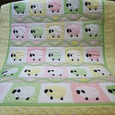 Spring Sheep. Precious! Done in pastels. Appliques attached with fusible webbing and outline stitched. Vine accented with hearts or tulips. On Etsy.