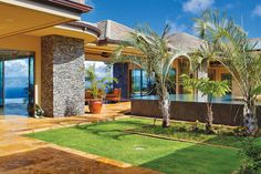 Warm toned walkways contract beautifully against green flora and a cool toned rock wall element.
