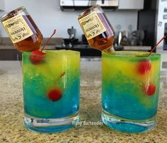 "YOU, ME & HENNESSEY 1 oz (30 ml) Green Apple Vodka 1 oz (30 ml) Creme de Banana Splash Blue Curacao Crushed Ice Cherries Mango Nectar Mini ""Nip"" Henny Bottle"