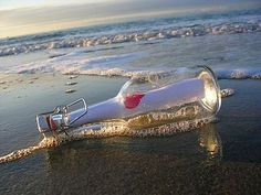 message in a bottle, send off at sea, celebration of our 2nd wedding anniversary, since he's most likely going to be at sea.