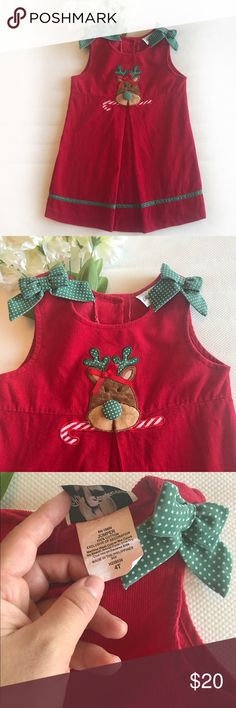 Reindeer Corduroy Christmas Dress/Jumper Reindeer Red Corduroy Christmas Dress/Jumper. 100% Cotton. So adorable with a white T or Long Sleeve underneath. Fantastic condition. 2 bows at each side. Stitched on reindeer. Buttons on the back. 🌟FAST SHIPPER🌟❣️AMBASSADOR❣️💚BUNDLE & SAVE💚 Dresses
