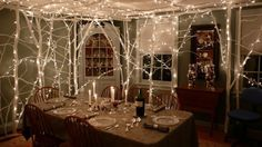 We want to be invited to this dinner party! Bring the outdoors in and light up the night.  Use LED so you can run longer lengths and they don't get as hot. So many options available here: http://www.partylights.com/LED/LED-String-Lights
