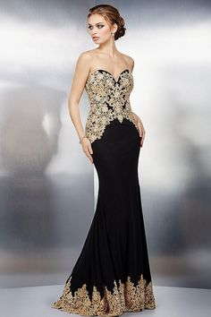Gorgeous black strapless fitted evening gown features sweetheart neckline and gold details with crystal embellishment throughout.