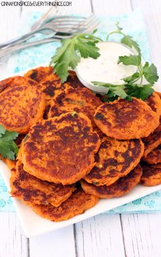 Pan-fried sweet potato cakes, golden brown on the outside and creamy in the middle with a sour cream and yogurt sauce for dunking.