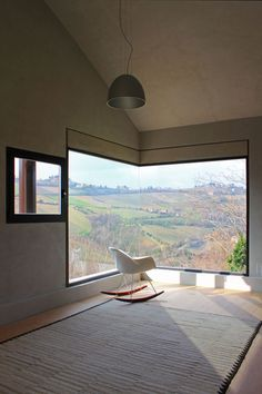 Large corner window that offers beautiful landscape views