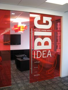 Transparent, colored walls with big logo.