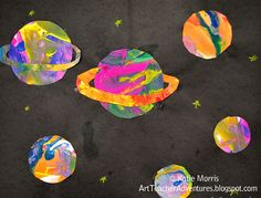 Painted planets.  Basically, you give the children paints, paintbrushes, and sheets of paper.  Let them go to town.  When dry, let them trace around various circle shapes to create planets.  They can then cut them out, and paste them to a sheet of black construction paper.  (I'd spray it with diluted white paint first, to make a starry sky background).