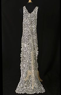 Handmade Brussels Duchesse lace wedding train, c.1910. The train is shaped to attach to your gown at the shoulders. The upper portion has a small floral pattern of Brussels bobbin lace; the lower portion has wide borders of Duchesse lace. The subtle elaborations and intricacies of the floral design are of the last degree of charm. Here are the highly stylized, flowing, curvilinear forms characteristic of Art Nouveau. An exacting technique is required to achieve the refined and subtle complexi...