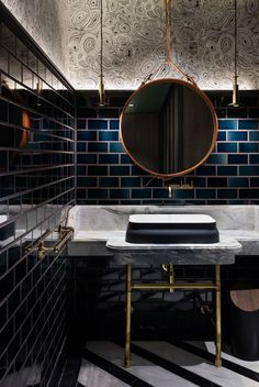 dramatic effect with a mix of classic brass detailing, a 1950s Mirror, contemporary lighting and a bold approach to color and pattern.  Bathroom by House of Beast | Photo by Dennis Lo