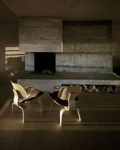 concrete fireplace and eames chairs. herman miller. - photo via Campbells Loft fb webpage