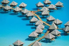 Bora bora island french polynesia.. i would love to stay in these lil tiki huts!