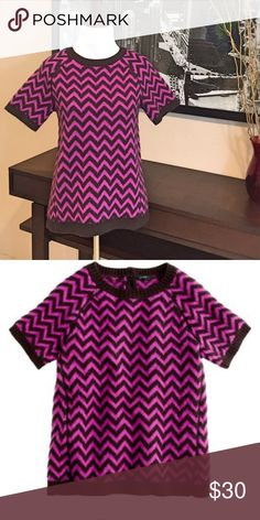 J. Crew Pink & Brown Chevron Merino Wool Sweater J. Crew Pink & Brown Chevron Merino Wool Sweater. Short sleeve, a-line, buttons at back of neck. Rib trim at neck, sleeve cuffs and bottom hem. No pulls or pulling. Wool could use a good cleaning - it has been in storage. No need for it is SoFL. Good used condition but lots of life left. Size XS but will fit a size Small. J. Crew Sweaters