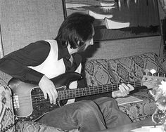 Bass player John Entwistle of the rock and roll band 'The Who' rehearses in a hotel room in August 1979 in Los Angeles, California.