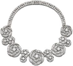 A unique diamond necklace, Cartier, 1942. The front designed as a series of articulated stylised roses and floral motifs set with circular- and single-cut diamonds, each centring on a circular-cut stone, the back of geometrical links, similarly set, inner circumference approximately 425mm, signed Cartier, fitted case signed Cartier, New York. Sotheby's.