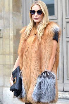 Poppy Delevigne wears an oversized fur at the Louis Vuitton show.   - ELLE.com