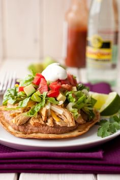 Loaded chicken tostadas layered with guacamole, refried beans, tomatoes, and chiles! Perfect for weeknights or game day. Tostadas are delicious and hearty comfort food. Slow Cooker Huhn, Slow Cooker Recipes, Crockpot Recipes, Chicken Recipes, Cooking Recipes, Healthy Recipes, Recipe Chicken, Cooking Tips, Cashew Chicken
